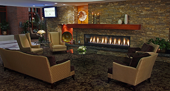 Large stone fireplace and comfortable chairs in a lounge at the High Country Conference Center