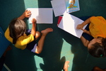 Primary school students work on their writing