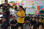 Primary school student reads to class in Maori
