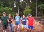 Students building a rain garden by Wade Worthen